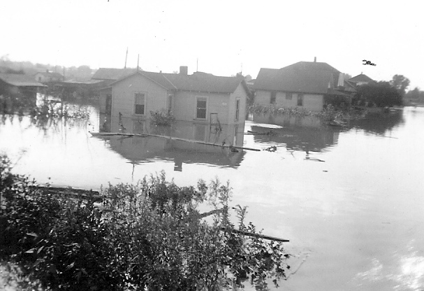 old photo of house flooded in 1935