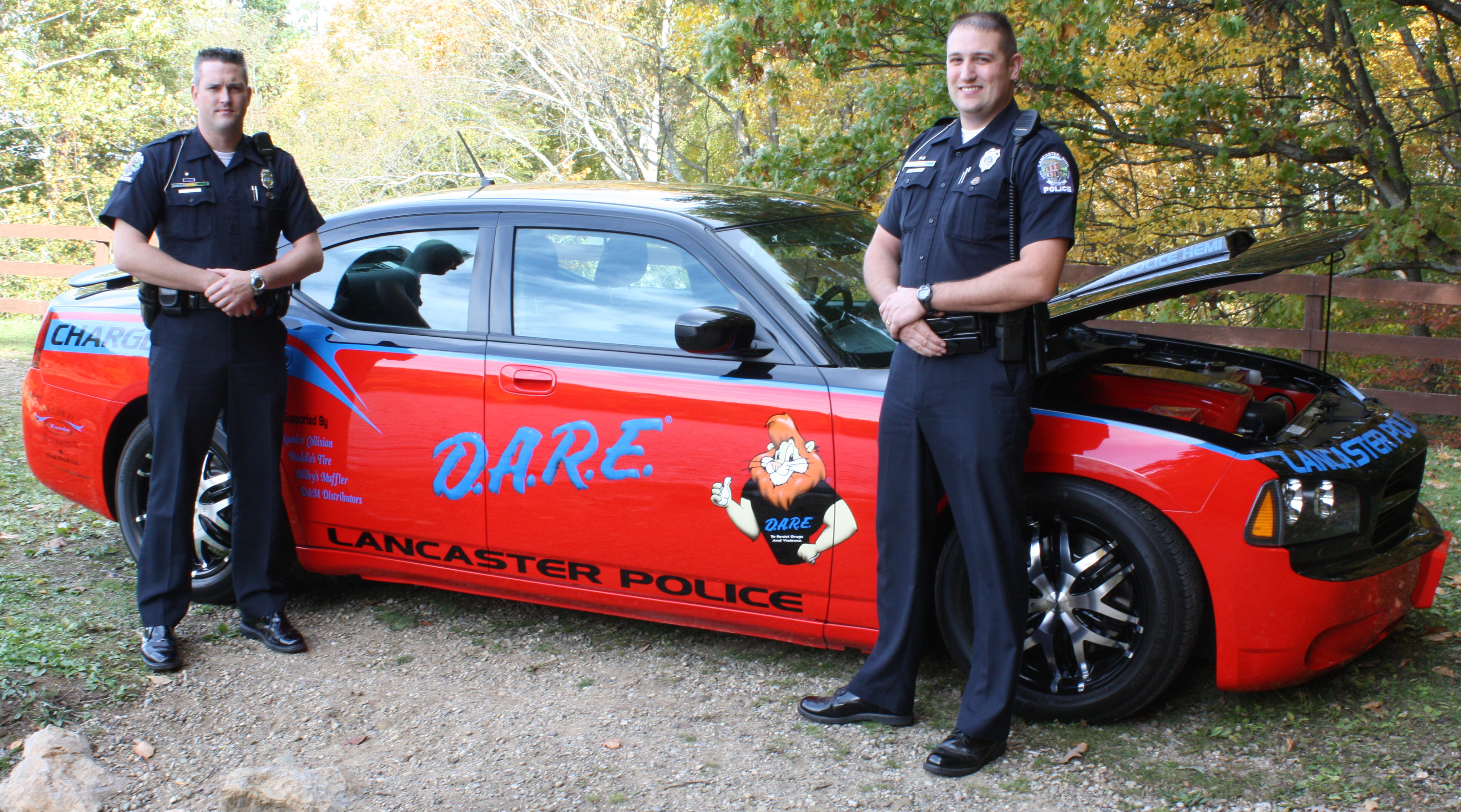 Officers Jim Marshall and Chris Caton with DARE Car