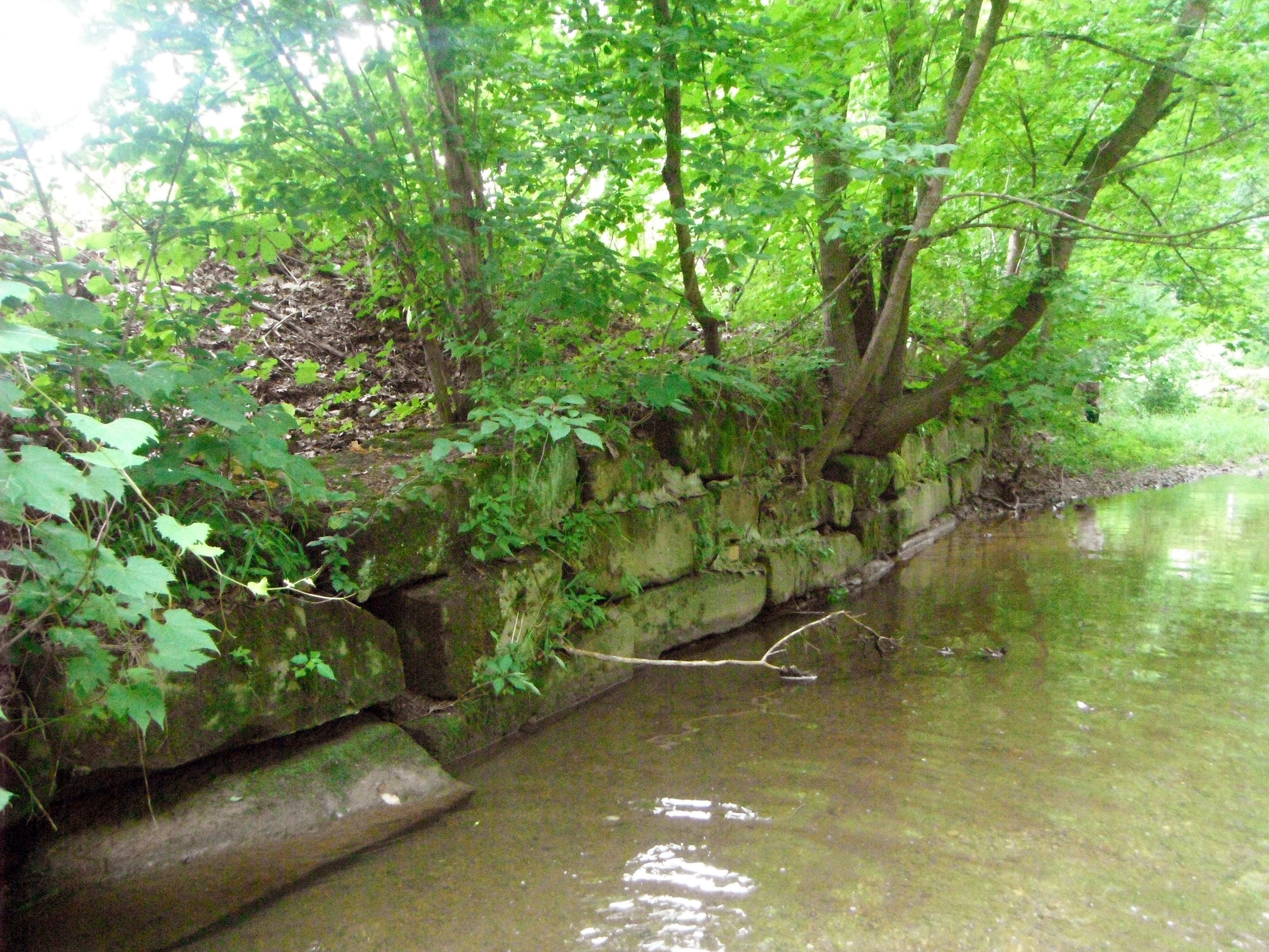 Retaining wall in stream